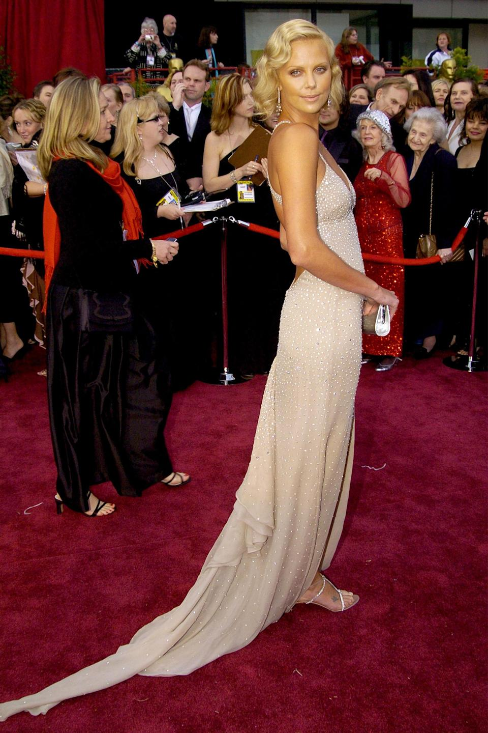 """<h2>Charlize Theron, 2004</h2><br>Is Charlize Theron ever not glowing?<br><br><em>Charlize Theron in Dior.</em><span class=""""copyright"""">Photo: Jeff Kravitz/FilmMagic/Getty Images.</span>"""