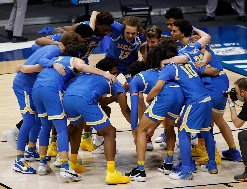 The UCLA Bruins huddle up before tipoff during the first round of the 2021 NCAA Tournament on Saturday, March 20, 2021, at Hinkle Fieldhouse in Indianapolis, Ind.
