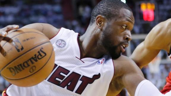 Chicago-born Dwyane Wade saves the damage for late, Miami knocks off the Chicago Bulls in Game 5