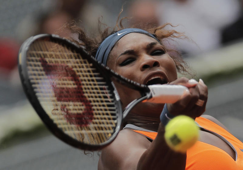 Serena Williams from U.S. returns the ball to Lourdes Dominguez Lino from Spain during their match at the Madrid Open tennis tournament, in Madrid, Tuesday May 7, 2013. (AP Photo/Andres Kudacki)