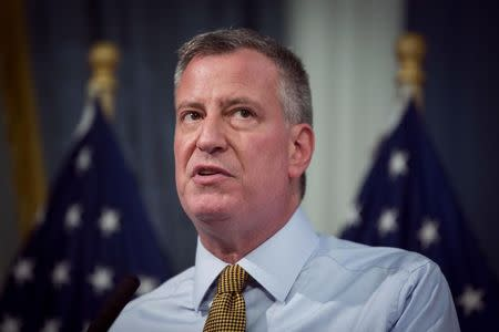 New York City mayor de Blasio speaks about the city's emergency preparedness for a summer storm bearing down on New York, at an official weigh in for the Nathan's Famous Fourth of July International Hot Dog Eating Contest at City Hall in New York
