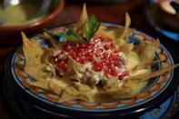 A chilaquiles version of chile en nogada with tortilla chips
