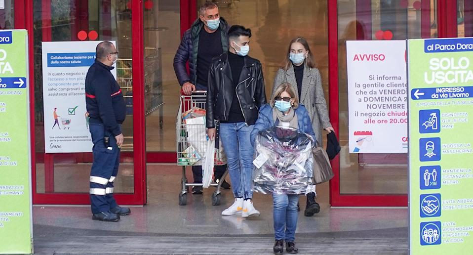 People leave a shopping centre in Italy. Source: EPA