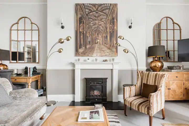 """<p>Like something out of an interiors magazine, this stunning flat in Bath was decorated to impress. It's set right in the centre of the city, allowing you to gaze through the vast Georgian windows at postcard views of the River Avon and Pulteney Bridge. The Airbnb boasts original 18th century architectural details and high ceilings to maintain the elegance. A gallery space above the lounge provides an additional sitting area and has a sofa bed for a fifth or sixth guest.</p><p><strong>Sleeps: </strong>Six</p><p><a class=""""link rapid-noclick-resp"""" href=""""https://airbnb.pvxt.net/WDY1gM"""" rel=""""nofollow noopener"""" target=""""_blank"""" data-ylk=""""slk:SEE INSIDE"""">SEE INSIDE</a></p>"""