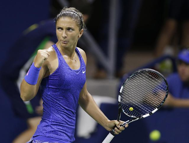 Sara Errani, of Italy, reacts after winning a game against Anastasia Rodionova, of Australia, during the second round of the U.S. Open tennis tournament Wednesday, Aug. 27, 2014, in New York. (AP Photo/Darron Cummings)