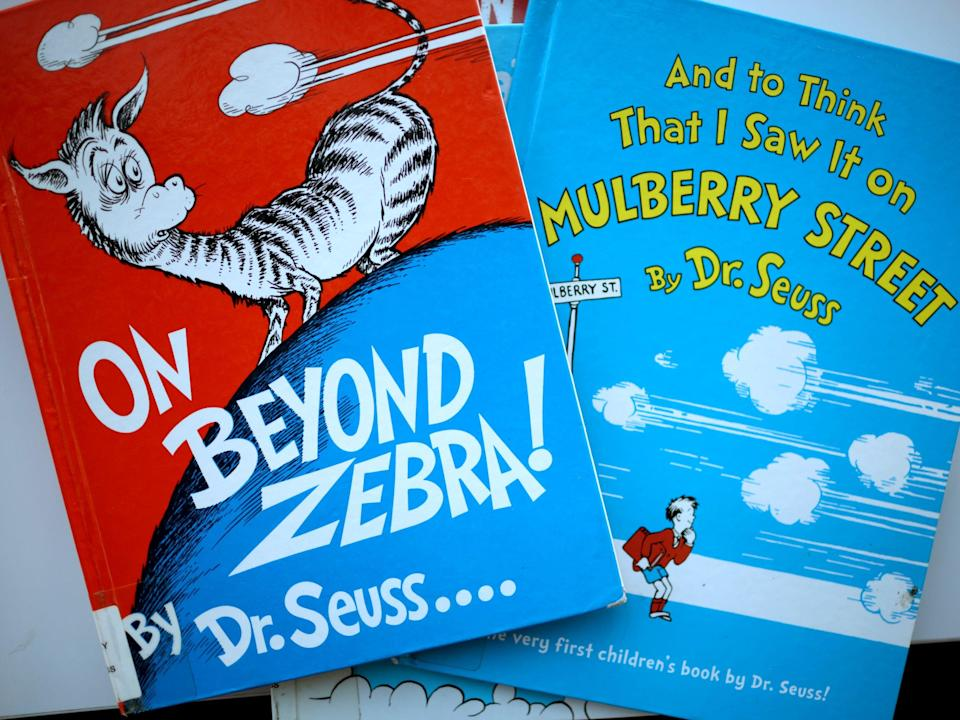 Two of the six Dr Seuss books that have been pulled from publication (Scott Olson/Getty Images)