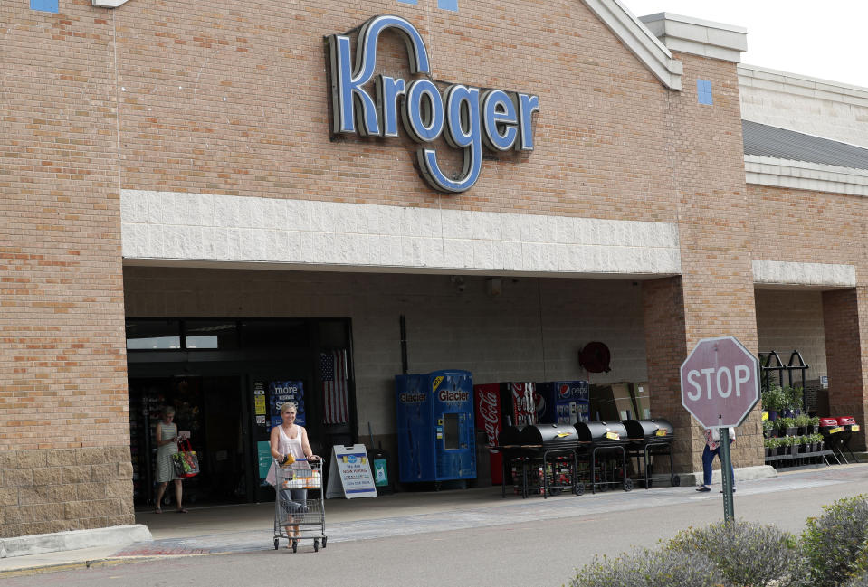 A customer exits a Kroger grocery store in Flowood, Miss., Wednesday, June 26, 2019. (AP Photo/Rogelio V. Solis)
