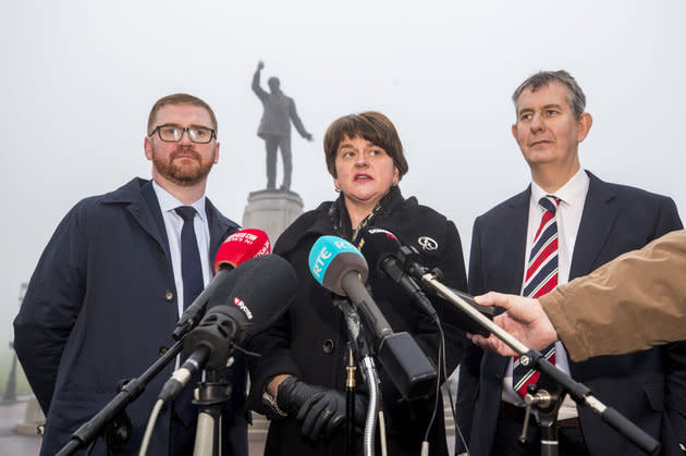 DUP leader Arlene Foster, with party colleagues Simon Hamilton and Edwin Poots (right), speaks with media at Carson Statue after talks with the new Secretary of State for Northern Ireland Karen Bradley at Stormont House.