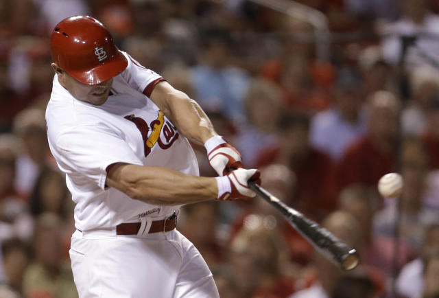 St. Louis Cardinals' Matt Holliday hits an RBI double during the third inning of a baseball game against the Pittsburgh Pirates on Friday, Sept. 6, 2013, in St. Louis. (AP Photo/Jeff Roberson)