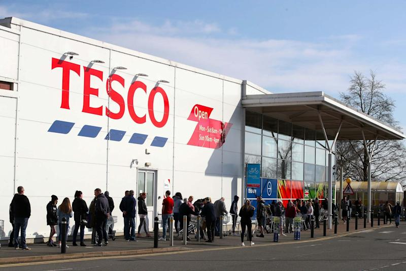 Tesco shoppers queue to get in (PA)