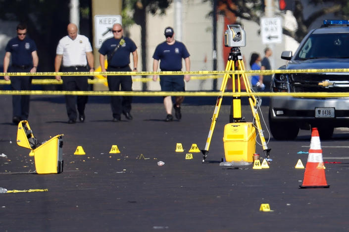 Evidence markers rest on the street at the scene of a mass shooting, Sunday, Aug. 4, 2019, in Dayton, Ohio. Nine people in Ohio have been killed in the second mass shooting in the U.S. in less than 24 hours, and the suspected shooter is also deceased, police said. (Photo: John Minchillo/AP)