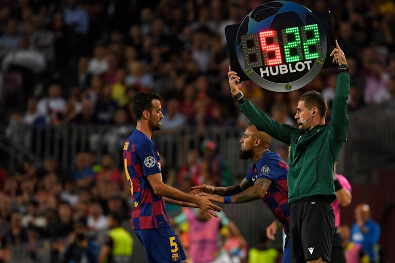 Barcelona's Spanish midfielder Sergio Busquets (L) is substituted off for Barcelona's Chilean midfielder Arturo Vidal during the UEFA Champions League Group F football match between Barcelona and Inter Milan at the Camp Nou stadium in Barcelona, on October 2, 2019. (Photo by LLUIS GENE / AFP) (Photo by LLUIS GENE/AFP via Getty Images)