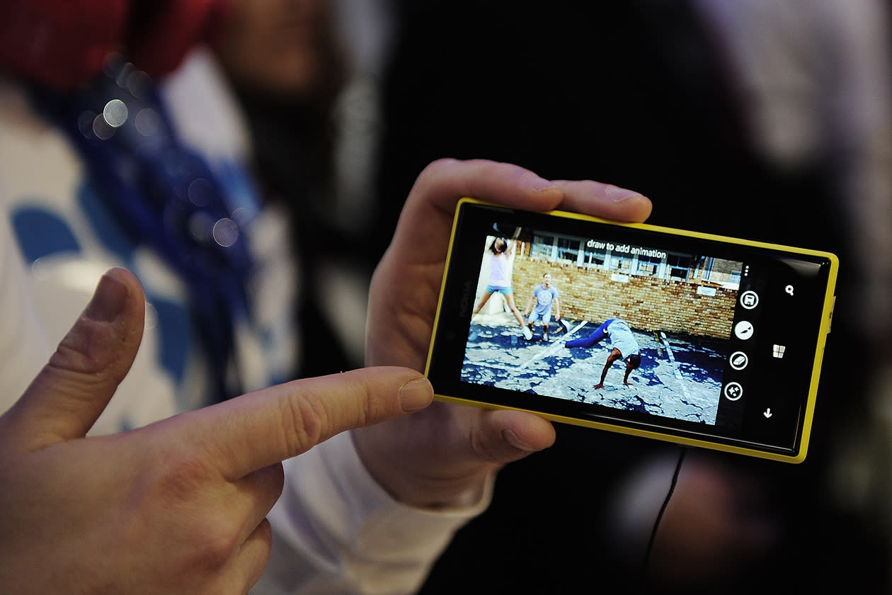 A man holds the new Nokia Lumia 720 at the Mobile World Congress. Nokia unveiled a cheaper model in its Lumia smart phone range, powered by Microsoft's Windows phone software, as it tries to regain dominance in emerging markets like China. Nokia CEO Stephen Elop also revealed the Lumia 720, a higher-priced smart phone for countries like China that lack advanced wireless data networks. He said China Mobile, the world's largest cellphone company, will sell both models.