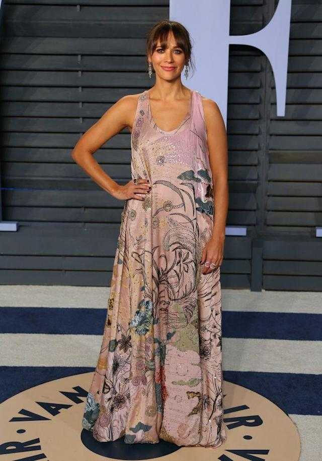 <p>The writer and actress chose a printed maxi for the party. (Photo: JEAN-BAPTISTE LACROIX/AFP/Getty Images) </p>