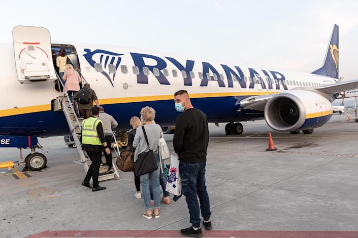 Passengers in protective face masks are seen waiting for departure of Ryanair flight at Krakow Balice Airport as the airline industry is trying to recover after global Coronavirus lockdown cut most of international passenger flights - Krakow, Poland on September 14, 2020. (Photo by Dominika Zarzycka/NurPhoto via Getty Images)
