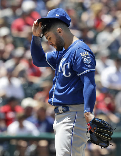 Kansas City Royals starting pitcher Jakob Junis adjusts his cap in the fourth inning in a baseball game against the Cleveland Indians, Wednesday, June 26, 2019, in Cleveland. (AP Photo/Tony Dejak)