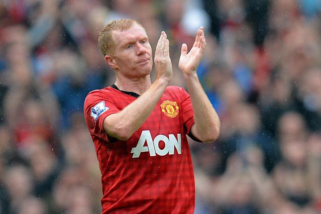 File picture taken on May 12, 2013 Manchester United's English midfielder Paul Scholes acknowledges the crowd during his side's English Premier League match against Swansea City at Old Trafford (AFP Photo/Andrew Yates)