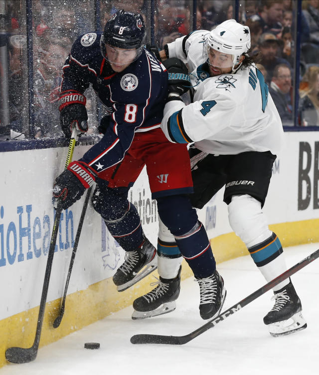 San Jose Sharks' Brenden Dillon, right, checks Columbus Blue Jackets' Zach Werenski during the second period of an NHL hockey game Saturday, Jan. 4, 2020, in Columbus, Ohio. (AP Photo/Jay LaPrete)