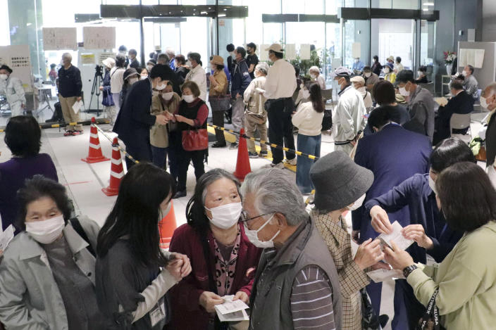 A floor is crowded with elderly people who want to make a reservation for the coronavirus vaccine in Kochi, western Japan on April 23, 2021. Japan's rollout of COVID-19 vaccines began belatedly in mid-February, months behind the United States and many other countries. Officials blamed a shortage of Pfizer Inc. vaccine from Europe as the main culprit in the delay. But three months later, with shipments stabilized and officials attempting to accelerate vaccinations, Japan remains one of the world's least protected. (Kyodo News via AP)