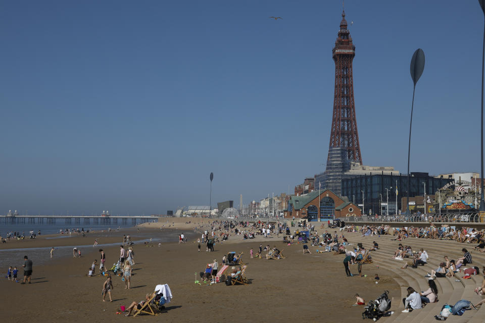 Domestic tourists enjoying the scorching hot weather on the beach, some with deck chairs, with the world famous Blackpool Tower in the background as temperatures in the country are expected to soar this week on 7th September, 2021 in Blackpool, United Kingdom. Temperatures in the UK are predicted to soar to highs of 29 degrees celsius, coinciding with a rise in daycation and staycation domestic tourism in the country as a result of Covid-19 precautions that make foreign travel increasingly costly and difficult. (photo by Daniel Harvey Gonzalez/In Pictures via Getty Images)