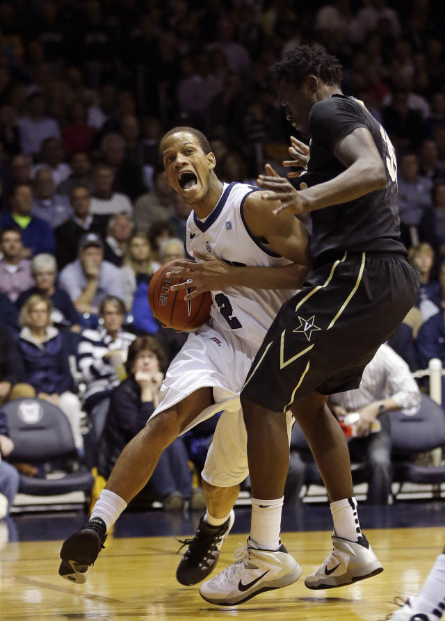 Butler's Devontae Morgan (2) goes to the basket against James Siakam (35) during the first half of an NCAA college basketball game Tuesday, Nov. 19, 2013, in Indianapolis. (AP Photo/Darron Cummings)