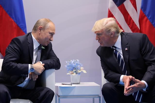 Russia's President Vladimir Putin talks to U.S. President Donald Trump during their bilateral meeting at the G20 summit in Hamburg. REUTERS/Carlos Barria