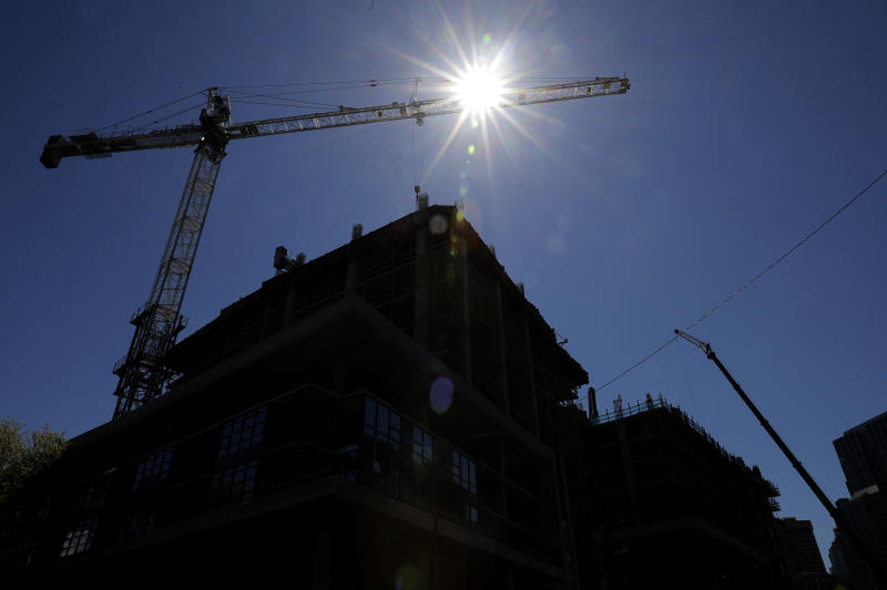 Cranes are shown at the site of a building under construction, Monday, April 29, 2019, in Seattle. On Saturday, a crane at a different location in Seattle collapsed and fell, killing several people. (AP Photo/Ted S. Warren)