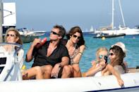 <p>Cindy Crawford and her husband Rande Gerber with friends on vacation in Saint-Tropez, France.</p><p>Other celebrity visitors this year: Lily Allen, Kate Moss, Leonardo DiCaprio, Ivana Trump.</p>