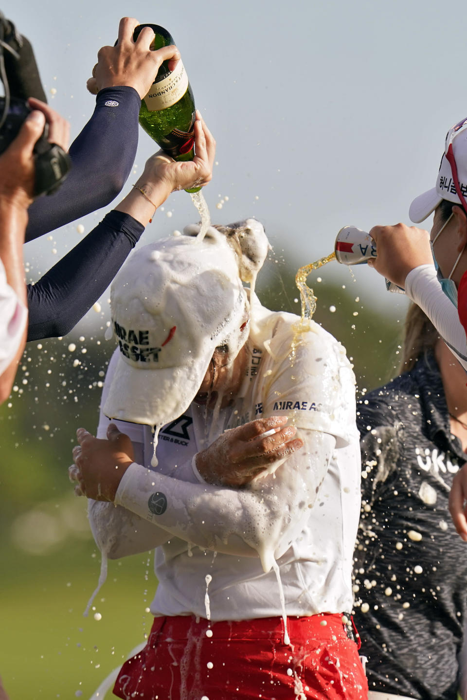 Sei Young Kim, of South Korea, gets doused with champagne after winning the LPGA Pelican Women's Championship golf tournament Sunday, Nov. 22, 2020, in Belleair, Fla. (AP Photo/Chris O'Meara)