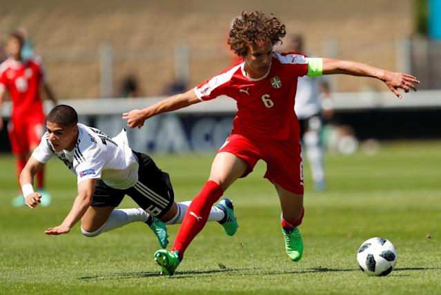 Soccer Football - UEFA European Under-17 Championship - Group D - Serbia v Germany - Loughborough University Stadium, Loughborough, Britain - May 8, 2018 Germany's Can Bozdogan in action with Serbia's Strahinja Erakovic Action Images via Reuters/Andrew Boyers