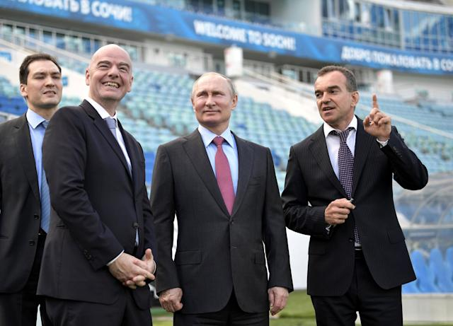 Russian President Vladimir Putin (2nd R), FIFA President Gianni Infantino (2nd L) and Governor of the Krasnodar Region Veniamin Kondratyev (R) visit the Fisht Stadium, which will host matches of the 2018 FIFA World Cup in Sochi, Russia May 3, 2018. Sputnik/Aleksey Nikolskyi/Kremlin via REUTERS ATTENTION EDITORS - THIS IMAGE WAS PROVIDED BY A THIRD PARTY.