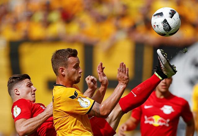 Football Soccer - Dynamo Dresden v RB Leipzig - German Cup (DFB Pokal) - DDV-Stadion, Dresden, Germany - 20/08/16. Dynamo Dresden's Manuel Konrad (R) in action with RB Leipzig's Marcel Sabitzer. REUTERS/Axel Schmidt. DFB RULES PROHIBIT USE IN MMS SERVICES VIA HANDHELD DEVICES UNTIL TWO HOURS AFTER A MATCH AND ANY USAGE ON INTERNET OR ONLINE MEDIA SIMULATING VIDEO FOOTAGE DURING THE MATCH.