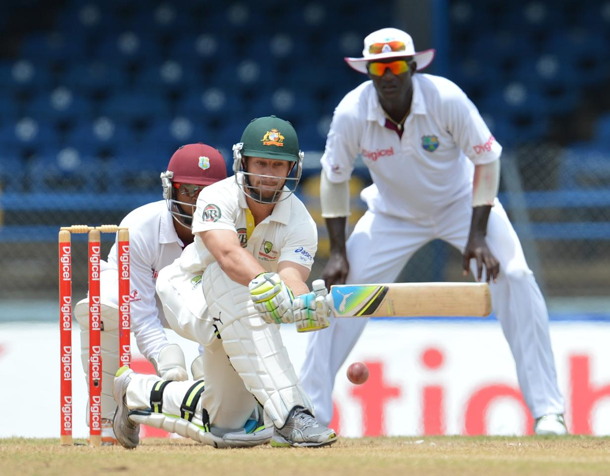 Australian batsman Matthew Wade plays a shot during the final day of the second-of-three Test matches between Australia and West Indies April19, 2012 at Queen's Park Oval in Port of Spain, Trinidad.