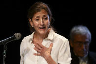 Former Colombian presidential candidate Ingrid Betancourt, who was abducted while campaigning by the Revolutionary Armed Forces of Colombia rebels, is overcome by emotion as she speaks during an event at the Truth Commission to commemorate victims of the country's decades-long armed conflict, in Bogota, Colombia, Wednesday, June 23, 2021. (AP Photo/Ivan Valencia)