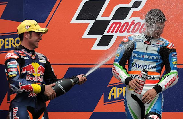 Blusens Avintia's Spanish Maverick Vinales (R) and Red Bull KTM Ajo's German Sandro Cortese (L) celebrate in the podium after the Moto3 race of the Catalunya Moto GP Grand Prix at the Catalunya racetrack in Montmelo, near Barcelona, on June 3, 2012. Blusens Avintia's Spanish Maverick Vinales won the race ahead of Red Bull KTM Ajo's German Sandro Cortese and Estrella Galicia's Portuguese Miguel Oliveira. AFP PHOTO / LLUIS GENELLUIS GENE/AFP/GettyImages