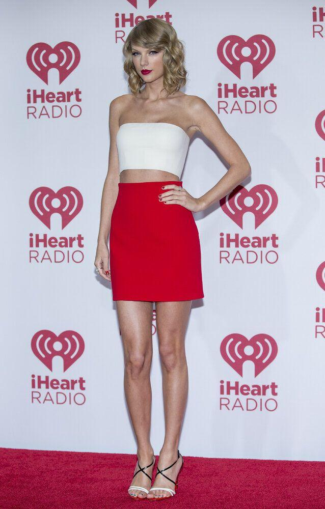 Taylor Swift arrives at the iHeartRadio Music Festival, Friday, Sept. 19, 2014, at The MGM Grand Garden Arena in Las Vegas. (Photo by Andrew Estey/Invision/AP)