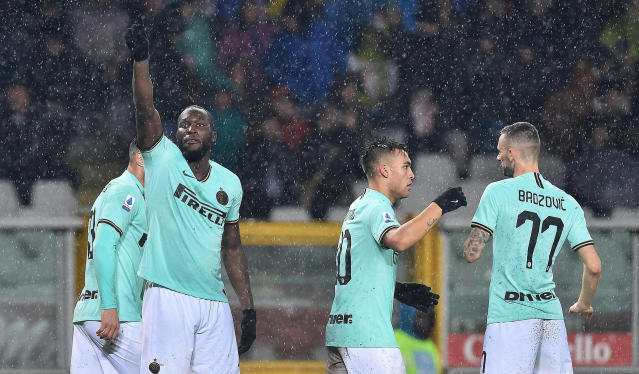 Inter's Romelu Lukaku, left, celebrates after scoring a goal during the Italian Serie A soccer match between Torino FC and Inter Milan at the Olimpico Grande Torino stadium in Turin, Italy, Saturday, Nov. 23, 2019. (Di Marco/ANSA via AP)