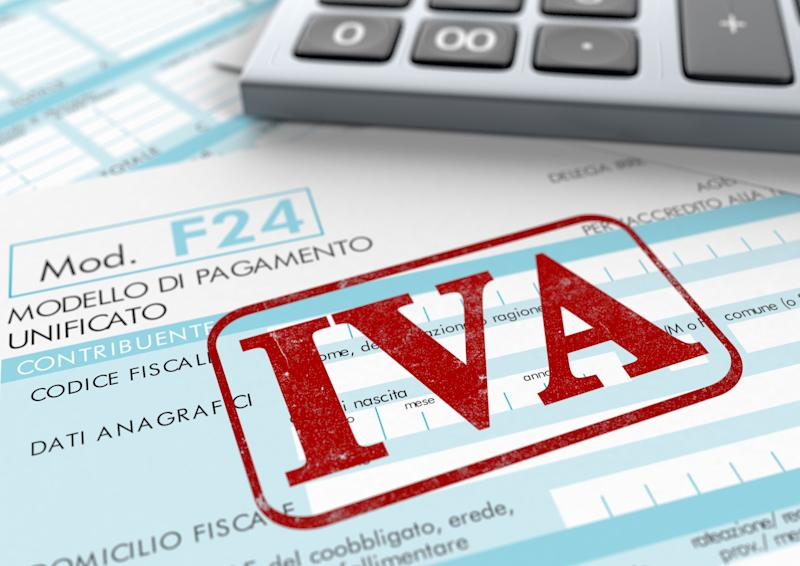 close up view of F24 form for italian taxes,the word iva and an electronic calculator (3d render) (Photo: lucadp via Getty Images)