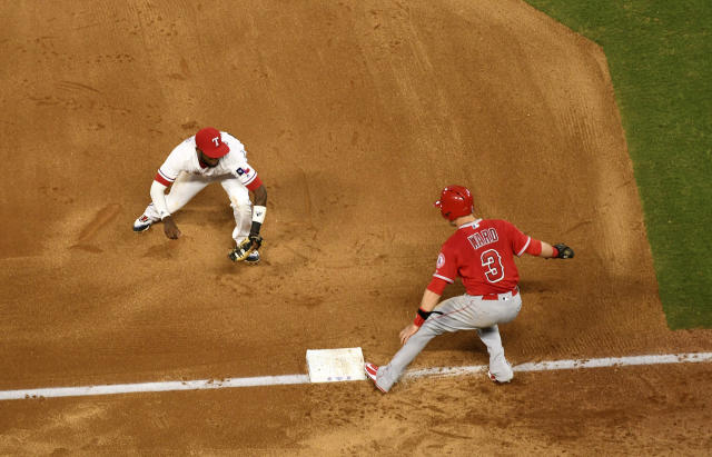 Texas Rangers shortstop Jurickson Profar runs to tag out Los Angeles Angels' Taylor Ward (3) for one out of a triple play on a ground ball by David Fletcher off of Texas Rangers starting pitcher Ariel Jurado during the fourth inning of a baseball game, Thursday, Aug. 16, 2018, in Arlington, Texas. Fletcher and Eric Young Jr. were also out on the play. (AP Photo/Jeffrey McWhorter)