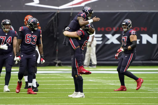 Houston Texans quarterback Deshaun Watson (4) celebrates with center Nick Martin (66) after throwing a touchdown pass against the Cincinnati Bengals during the first half of an NFL football game Sunday, Dec. 27, 2020, in Houston. (AP Photo/Eric Christian Smith)