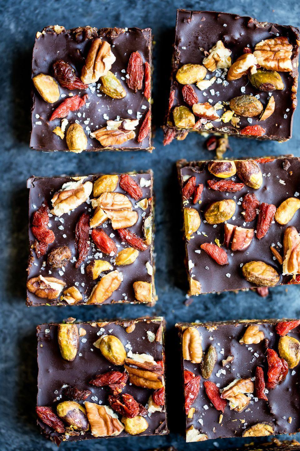 """<p>These rich dark chocolate brownies get lots of color from pistachios, goji berries, walnuts, chia seeds, and coconut.</p><p><a class=""""link rapid-noclick-resp"""" href=""""https://www.ambitiouskitchen.com/no-bake-superfood-brownie-energy-bars-video/"""" rel=""""nofollow noopener"""" target=""""_blank"""" data-ylk=""""slk:GET THE RECIPE"""">GET THE RECIPE</a></p><p><em>Per serving: 234 calories, 14.2 g fat, 26.9 g carbs, 18.2 g sugar, 6g fiber, 4.5 g protein</em></p>"""
