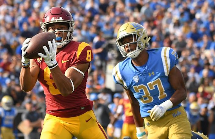 Wally SkalijLos Angeles Times STOPPING TALENTED RECEIVER Amon-ra St. Brown, shown catching a pass in front of UCLA's Quentin Lake last season, has been a problem for USC's young secondary during training camp.