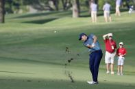 Jordan Spieth hits a shot off the 11th fairway during the first round of the Charles Schwab Challenge golf tournament at the Colonial Country Club in Fort Worth, Texas, Thursday, May 27, 2021. (AP Photo/Ron Jenkins)