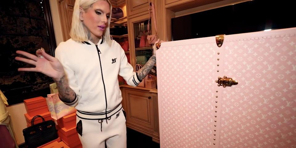 Jeffree Star with a Louis Vuitton chest