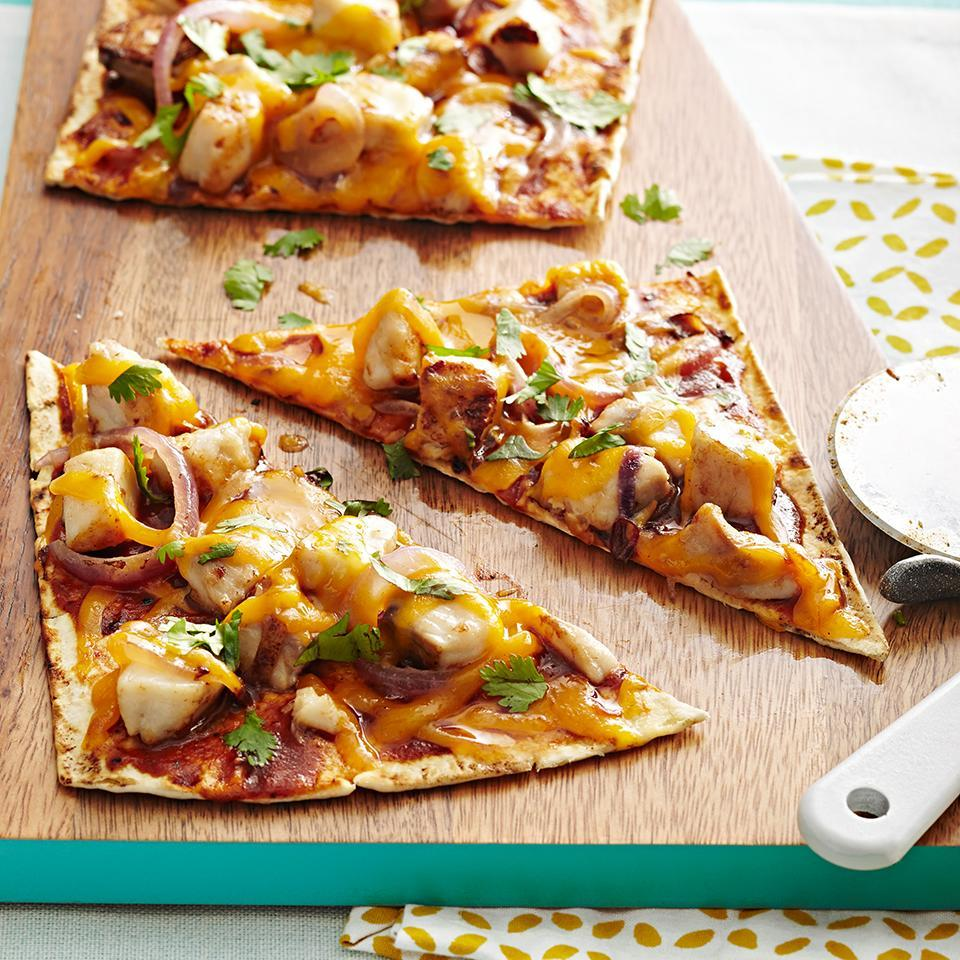 <p>Red onion, cheddar cheese, and cilantro are the perfect flavor combos in this fun pizza.</p>