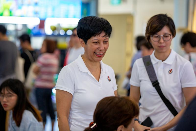 Tanjong Pagar GRC MP Indranee Rajah speaking to patrons at the Tiong Bahru Food Centre on Sunday (29 September). (PHOTO: Dhany Osman / Yahoo News Singapore)