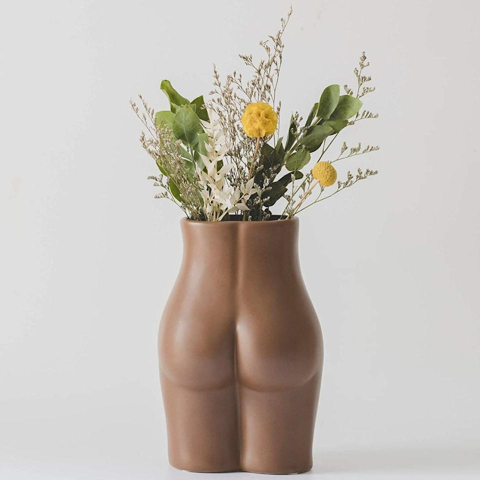 """Booty vases are all the rage, and artists on Etsy of delivering butts of all colors, shapes, and sizes. <em>Body-ody-ody-ody</em>… $22, Amazon. <a href=""""https://www.amazon.com/Female-Flower-Ceramic-Planter-Feminist/dp/B08FX7H8TF/ref="""" rel=""""nofollow noopener"""" target=""""_blank"""" data-ylk=""""slk:Get it now!"""" class=""""link rapid-noclick-resp"""">Get it now!</a>"""