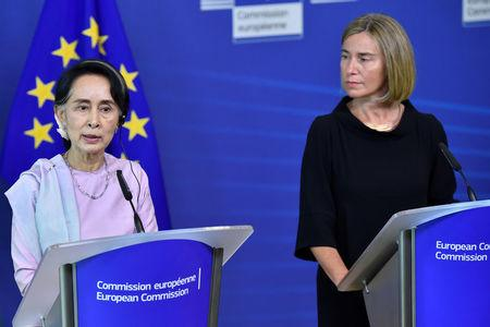 EU foreign policy chief Mogherini gives a news conference with Myanmar State Counsellor Suu Kyi in Brussels
