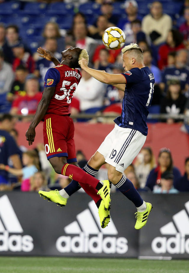 Real Salt Lake forward Sam Johnson (50) and New England Revolution defender Antonio Mlinar Delamea (19) battle for a head ball during the first half of an MLS soccer match at Gillette Stadium, Saturday, Sept. 21, 2019, in Foxborough, Mass. (AP Photo/Stew Milne)