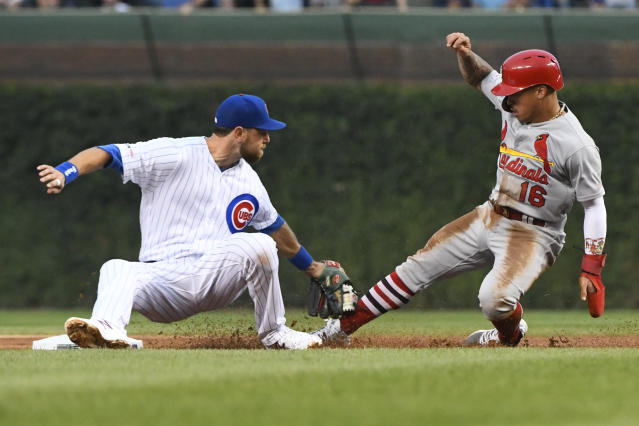 Chicago Cubs right fielder Ben Zobrist, left, tags out St. Louis Cardinals' Kolten Wong (16) at second base on an attempted steal during the first inning of a baseball game Thursday, Sept. 19, 2019, in Chicago. (AP Photo/Matt Marton)